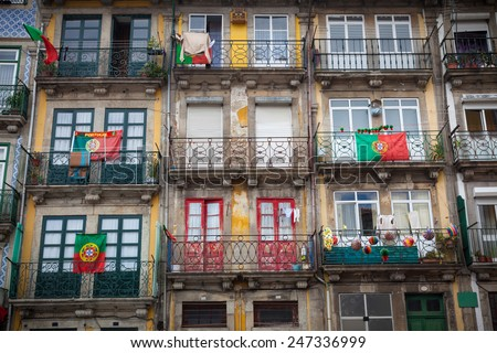 Old houses of Porto with flags in the balconies, Portugal