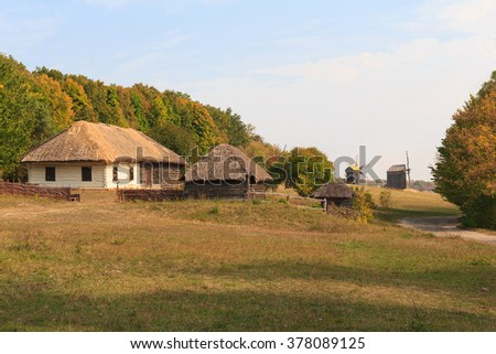 Old houses of the peasants and mill at the Museum of Pirogovo. Ukraine - stock photo
