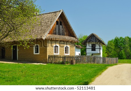 Old houses with roof from straw in wood - stock photo