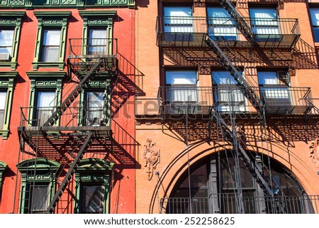 Old houses with stairs in the historic district of West Village - stock photo
