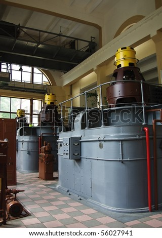 Old hydro power plant machine hall interior - stock photo