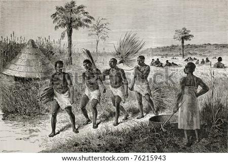 Old illustration of slaves in Unyamwezi region, Tanzania. Created by Bayard, published on Le Tour du Monde, Paris, 1864 - stock photo