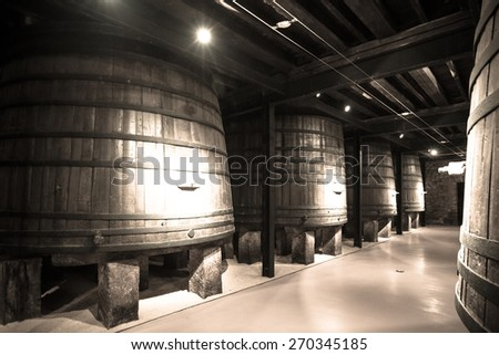 Old image  of  winery  with  wooden barrels  - stock photo