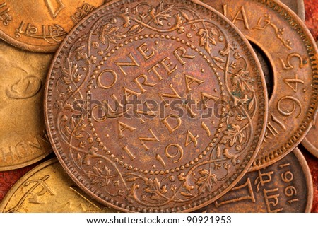 Old Indian Currency - One Quarter Anna - stock photo