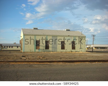 old industrial building with blue sky - stock photo