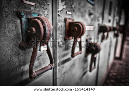 old industrial electronics switch cupboard in a firm - stock photo