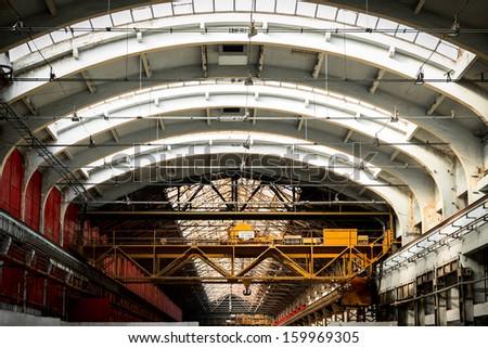 old industrial interior. crane capacity of twenty tons - stock photo