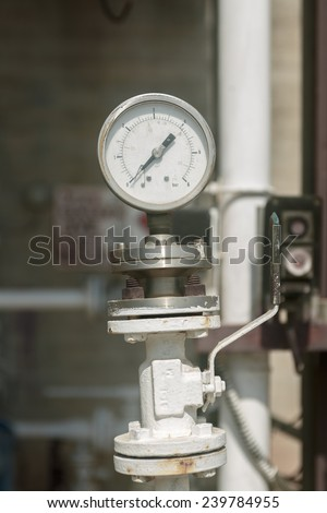 Old  industrial manometer on chemical plant - stock photo