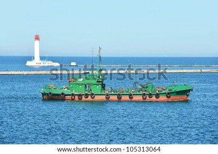 Old industrial pilot ship and lighthouse in Black sea