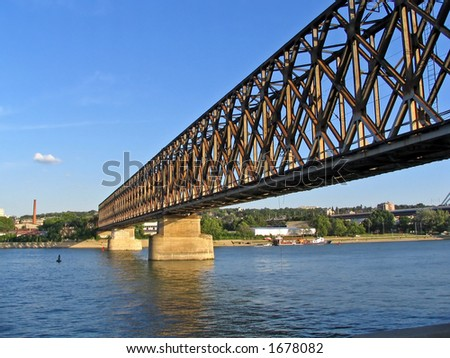 old industrial railway bridge for passenger and cargo transportation - stock photo
