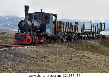 Old industrial train in Ny Alesund, Spitzbergen  - stock photo