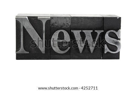 old, ink-stained metal letterpress type spells out the word 'news' isolated on white
