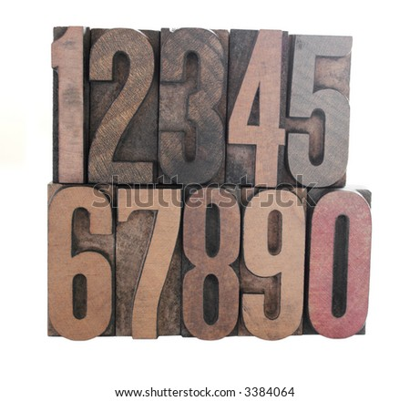 old, inkstained wood letterpress type numbers isolated on white