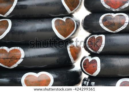 old inner tube with love logo - stock photo