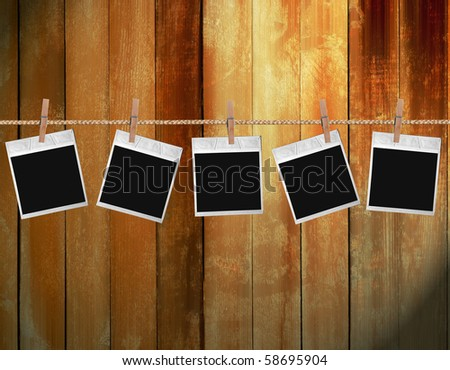 Old instant photos on antique backdrop - stock photo