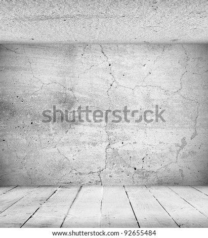 Old interior of an empty room with a grunge wall and stucco ceiling - stock photo