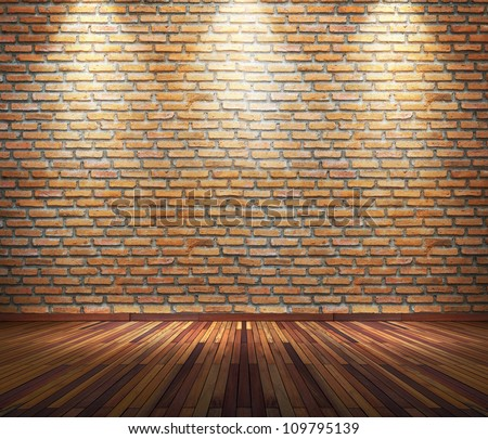 Old interior room with brick wall and three light spots - stock photo
