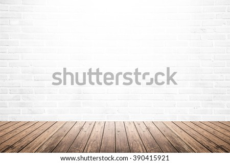 Old interior room with white brick wall texture and brown grunge wooden floor pattern, use for background, backdrop or design element - stock photo
