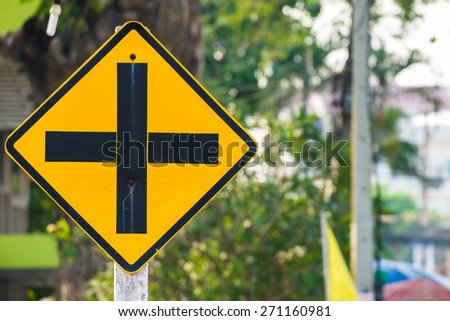 Old intersection road sign outdoor in the city - stock photo