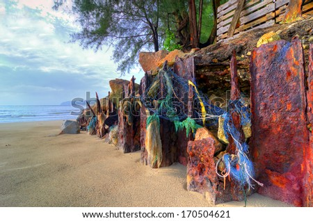 old iron cliff on the seashore - stock photo