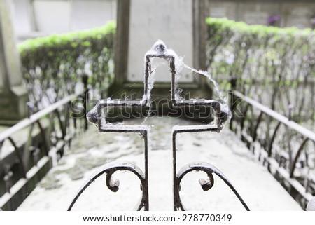 Old iron cross graveyard religion - stock photo