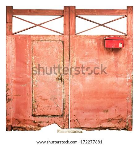 Old iron door red. - stock photo
