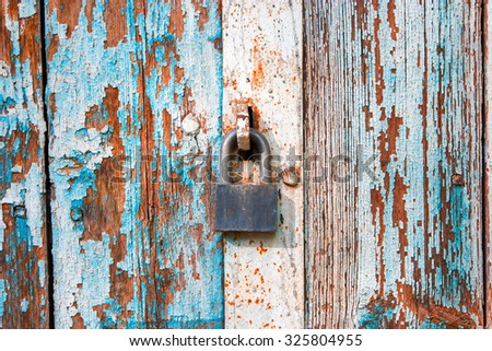 Old iron lock on weathered door in Astrakhan, Russia - stock photo