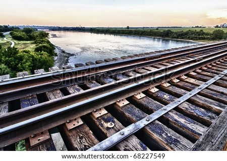 Old iron train bridge over the South Saskatchewan River in Saskatoon, Canada - stock photo