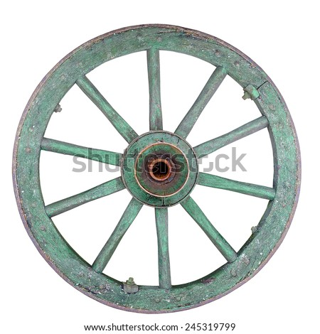 Old ironed, green wagon or carriage wheel on white background. - stock photo