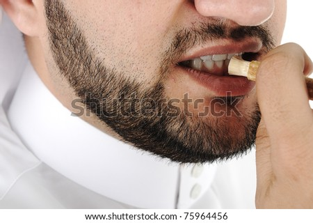 Old islamic traditional natural cleaning tool, siwak or miswak, today teeth brush - stock photo