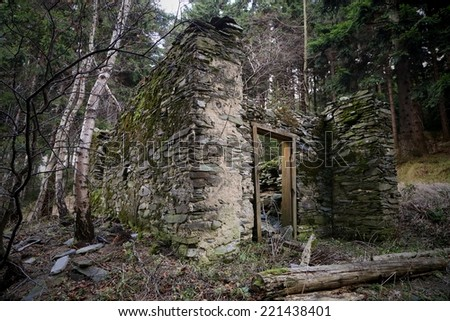 old isolated ruined stone house - stock photo