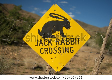 old jack rabbit crossing road sign at route 66, Arizona, United States of America - stock photo