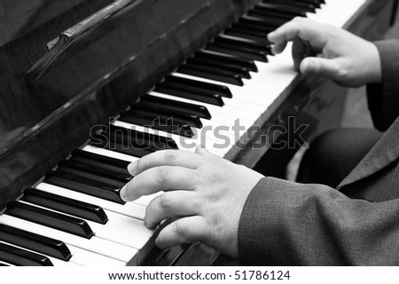 Old jazz musician plays piano - stock photo