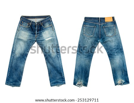 Old jeans on isolated white background - stock photo
