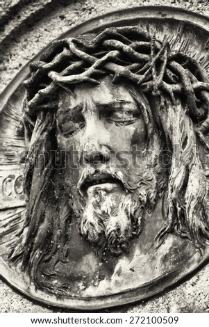 old jesus christ relief at a historic gravestone