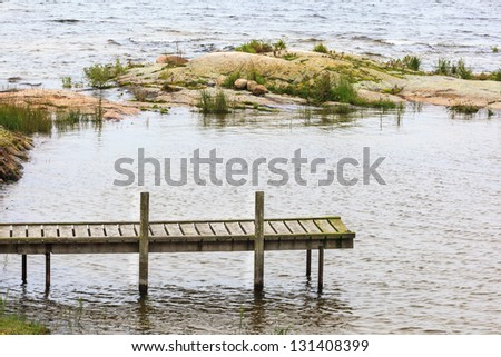 Old jetty at the lake - stock photo
