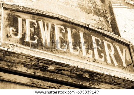 old jewellery sign at a store