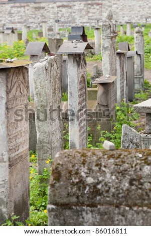 Old Jewish cemetery is located beside the Remuh Synagogue at 40 Szeroka Street in the historic Kazimierz district of Kraków. - stock photo