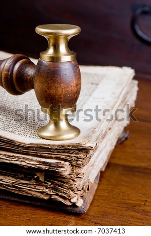 Old judge's gavel on an antique book of over 300 years old