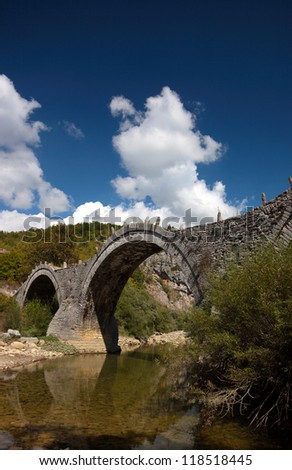 Old Kalogeriko triple arched stone bridge on Vikos canyon, Zagorohoria, Greece