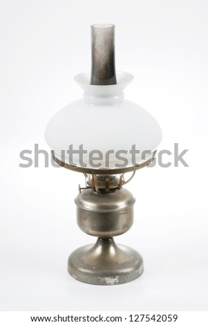 Old kerosene lamp , old oil lamp with a white shade .