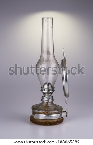 old kerosene lamp with mirror isolated on white background - retro