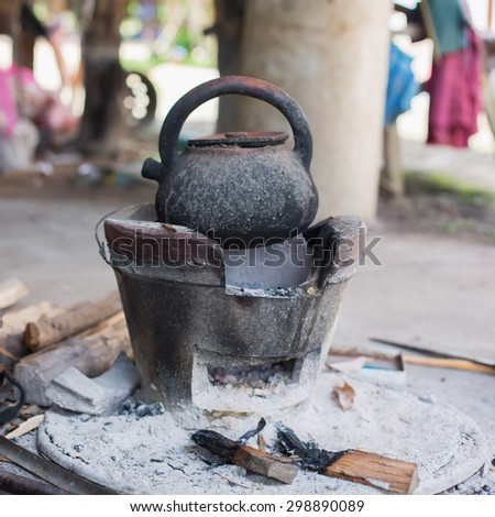 old kettle is on stove for boiling water - stock photo