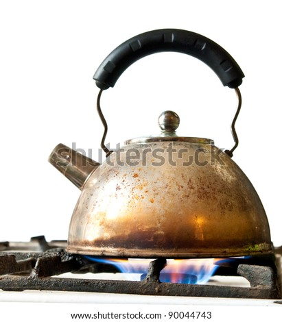 old kettle on a stove isolated on a white background - stock photo