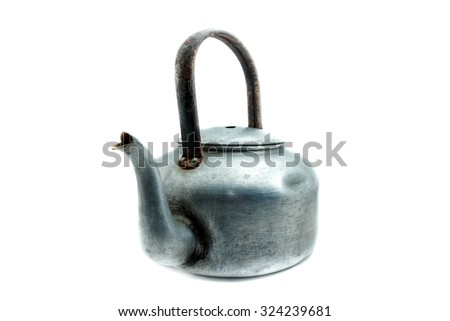 Old kettle on a white background. - stock photo