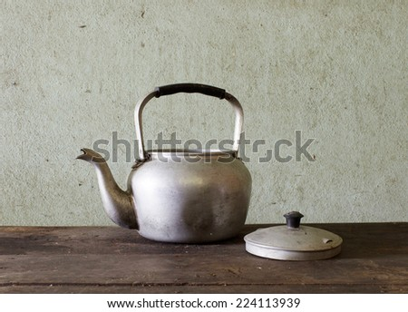 old kettle on wood
