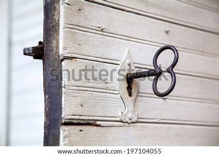 Old key in door, Sweden - stock photo
