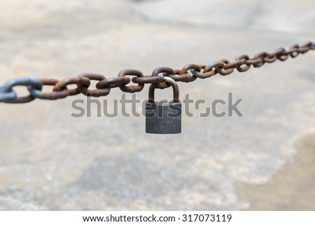 old key lock locked with a chain. - stock photo
