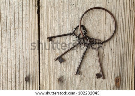 Old key on a wooden table - stock photo