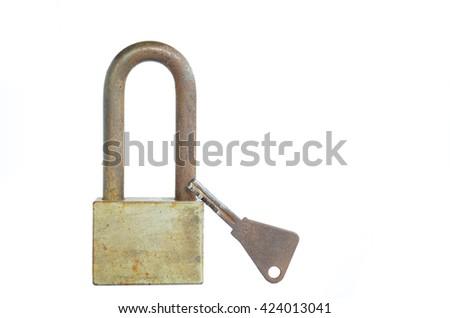Old key on white  background - stock photo